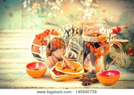 mulled wine with orange and spices on wooden background.Christmas decorationvintage filtersoft focus