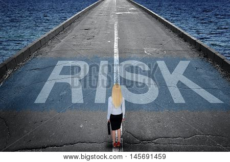 Risk message on road and business woman