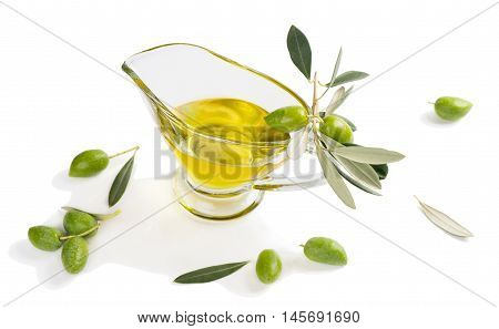 Sauceboat with olive oil and fresh green olives isolated on white background.