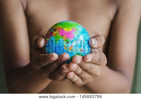 hands hold small globe concept map world