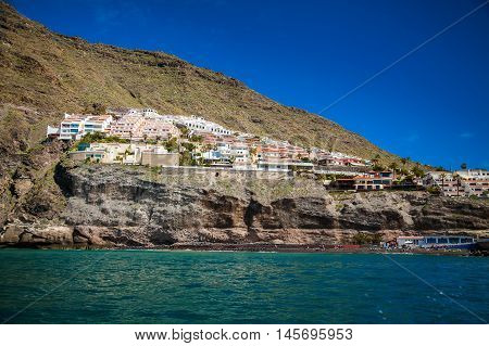 small village Los Gigantes and its beach from the ocean Tenerife Spain