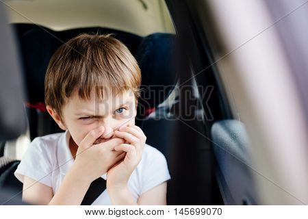 Child Suffers From Motion Sickness In Car