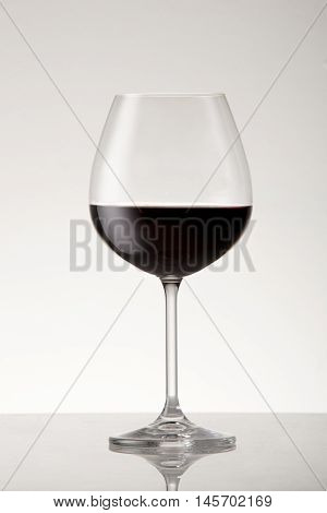 Bordeaux style red wine glass with red wine.