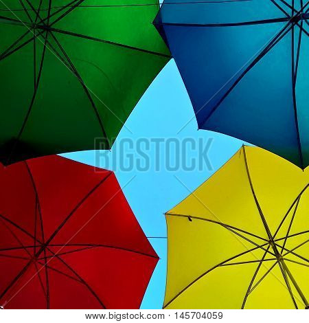 Colours of diversity represented by colourful umbrellas