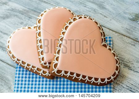 Heart shaped cookies. Glazed biscuits on a napkin. Find love and be happy. The strongest feeling.