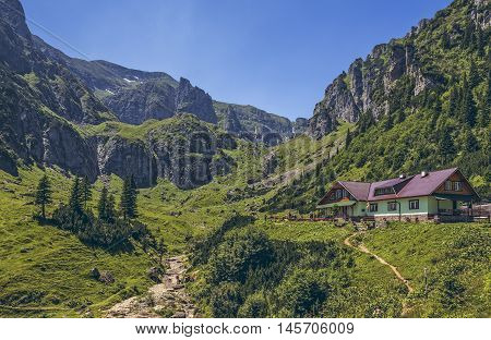 Bucegi Mountains Romania - 16 July 2016: Malaiesti cottage situated at 1720m altitude in Malaiesti Valley the most spectacular valley in Bucegi mountains.