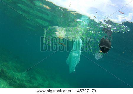 Environmental damage. Plastic pollution in ocean sea
