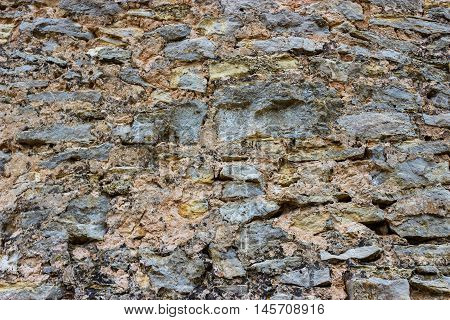 Fragment of ancient wall made of wild stone