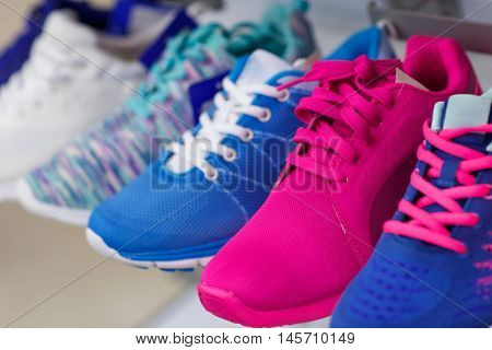 Variety of the colorful sneakers in the shop