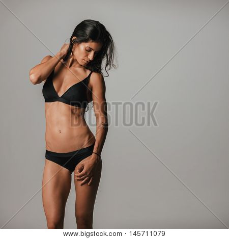 Beautiful Tanned Woman Wearing Black Under Garment