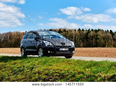 Germany - April 10 2016: Black colour Peugeot 5008 stopped on a rural road in Germany. The Peugeot 5008 is a French car and has been on sale since November 2009