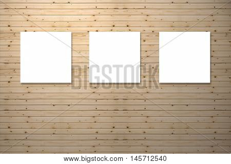 Three canvas frame on pine wooden wall for image advertising,brown wooden wall background,spot light added on toplight and shadow