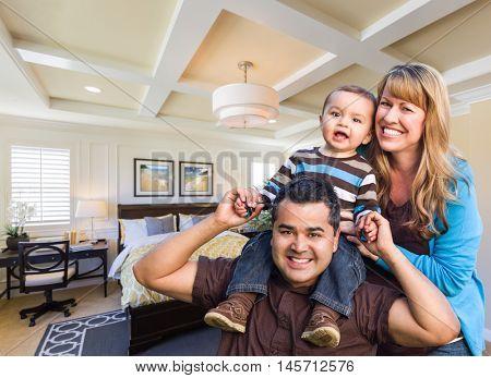 Happy Mixed Race Family In New Custom Bedroom.