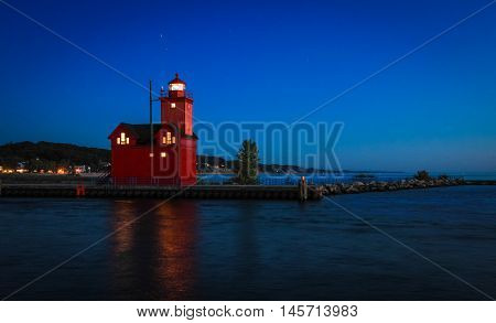 Holland Michigan Lighthouse At Night. The lighthouse in Holland, Michigan, known as Big Red. The current lighthouse was built in 1907 and the architecture reflects the Dutch influence from the surrounding area. Holland, Michigan.