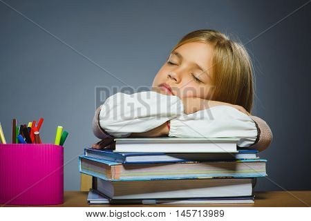 school concept. Closeup portrait girl asleep on pile of books.