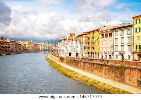 Pisa cityscape view on Arno river with Santa Maria Della Spina church in Italy