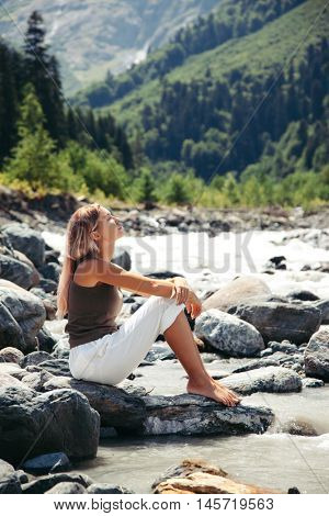 Traveler relaxing barefoot by the river.