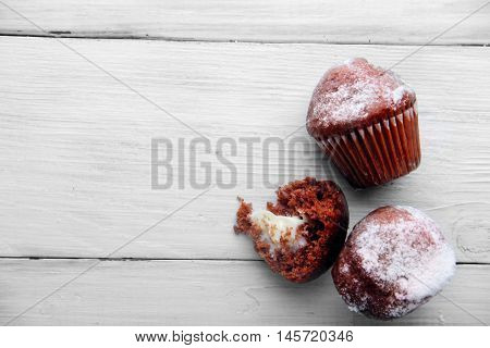 Two Chocolate And Biten Mini Muffins With Sugar Powder.top View .free Space