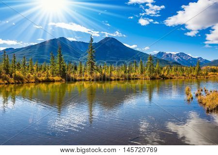 Magnificent sunset on lakes Vermilion in mountains National park Banff. The Rocky Mountains, Canada. Concept of active tourism and ecotourism