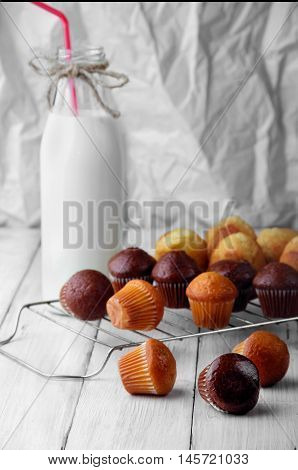 Chocolate And Simple Mini Muffins On White Wooden Table Scattered.selective Focus.three Muffins On F