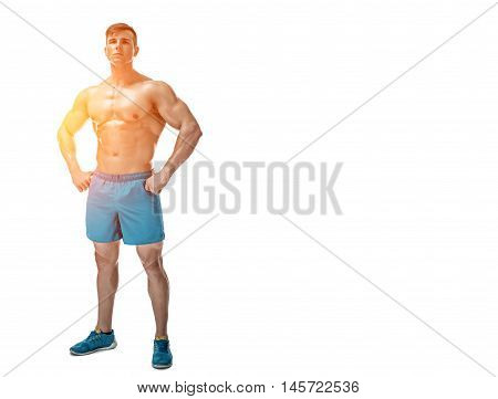 Strong Athletic Man showing muscular body and sixpack abs isolated on white background. full-length, copyspace