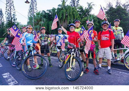 Kota Kinabalu,Sabah-Aug 31,2016:Cyclists all age and gender with Malaysia flag ready for National day parade,celebrating the 59th anniversary of independence on 31st Aug 2016 at Kota Kinabalu,Sabah