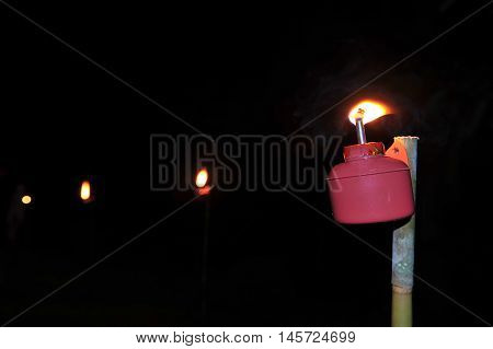 Oil Lamp with copy space and dark background.