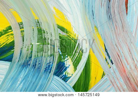 Brushstrokes of paint. Abstract art background. Oil painting on canvas. Multicolored bright texture. Fragment of artwork.