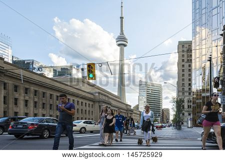 TORONTO,CANADA-AUGUST 1,2015:view of the CNN towers in Toronto during a sunny day from one of the central street of the city.