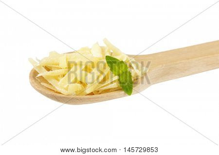 spoon of shredded parmesan cheese with basil