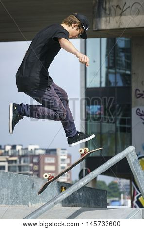 DORDRECHT NETHERLANDS - 3 SEPTEMBER 2016: Young skateboarder jumping during the warm-up at the official opening of the new skateboard park in Dordrecht.