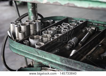 Socket wrench collection of car mechanic in auto repair service,selective focus
