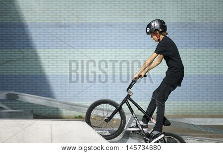 DORDRECHT NETHERLANDS - 3 SEPTEMBER 2016: Young biker working out during the warm-up at the official opening of the new skateboard park in Dordrecht.