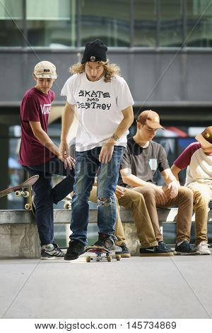 DORDRECHT NETHERLANDS - 3 SEPTEMBER 2016: Skateboarders hanging out at the official opening of the new skateboard park in Dordrecht as one starts his run.
