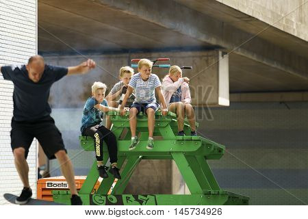 DORDRECHT NETHERLANDS - 3 SEPTEMBER 2016: Group of kids watching the skateboarders at the official opening of the new skateboard park in Dordrecht.