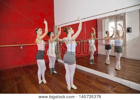 Ballerinas Performing In Front Of Mirror