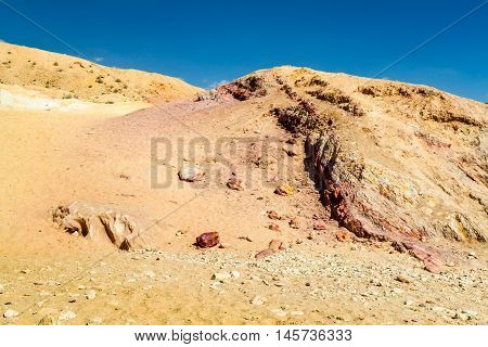 Colored sands in Makhtesh Gadol or Large Crater, nature reserve in Negev desert, Israel