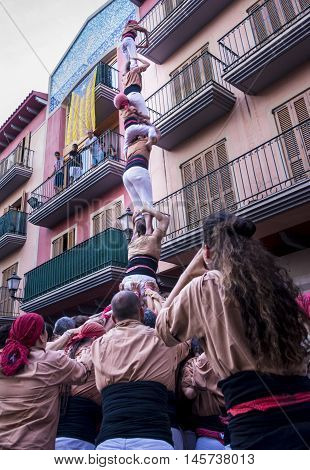 Cambrils, Spain. September 05, 2016: Castells Performance, a human tower built traditionally in festivals within Catalonia. This is also on the UNESCO Intangible Cultural Heritage of Humanity