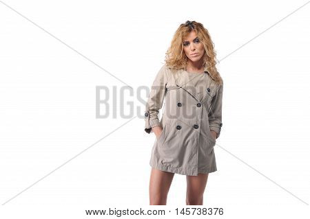 young blonde curly hair women wearing topcoat in studio