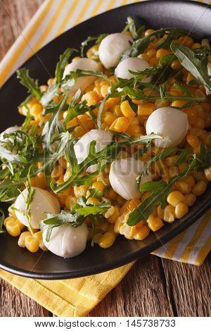 Low Calorie Salad Of Corn, Baby Mozzarella And Arugula Close-up. Vertical