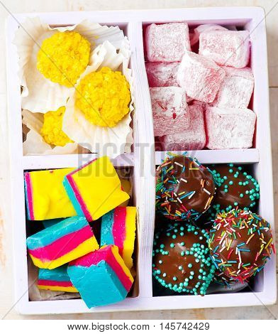 all sorts of handmade bonbons in a box. top view. selective focus