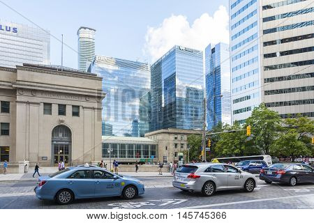 TORONTO,CANADA-AUGUST 1,2015:view of traffic and skyscrapers in Toronto during a sunny day from une of the central street of the city.