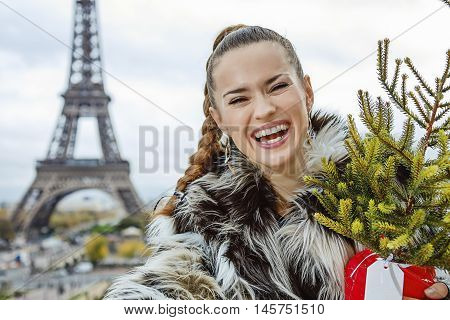 Smiling Fashion-monger With Christmas Tree Taking Selfie In Paris