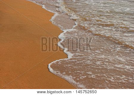 Golden Sand Background with wave, tropical lagoon resort, a lot of space for text.