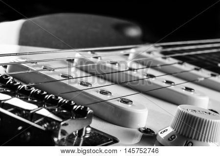 Cutting narrow the pick up and adjustment of an electric guitar in black and white