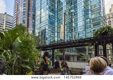TORONTO,CANADA-AUGUST 1,2015:People taking to drink or food in one of the many bars in Toronto.