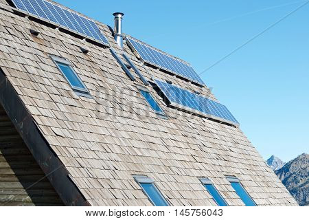 Photovoltaic panels on the roof of a hut, Ossau Valley, Pyrenees National Park, Pyrenees, France.