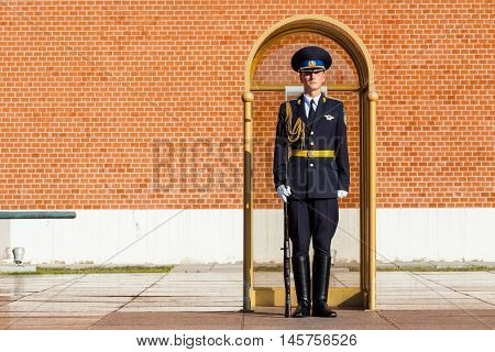 MOSCOW RUSSIA - SEPTEMBER 02 2016: Guard of the Presidential regiment of Russia near Tomb of Unknown soldier and Eternal flame in Alexander garden near Kremlin wall