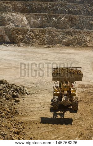 bulldozer working on the big open mine