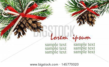 Christmas corner decorations with pine twigs cones and ribbon bow isolated on white background